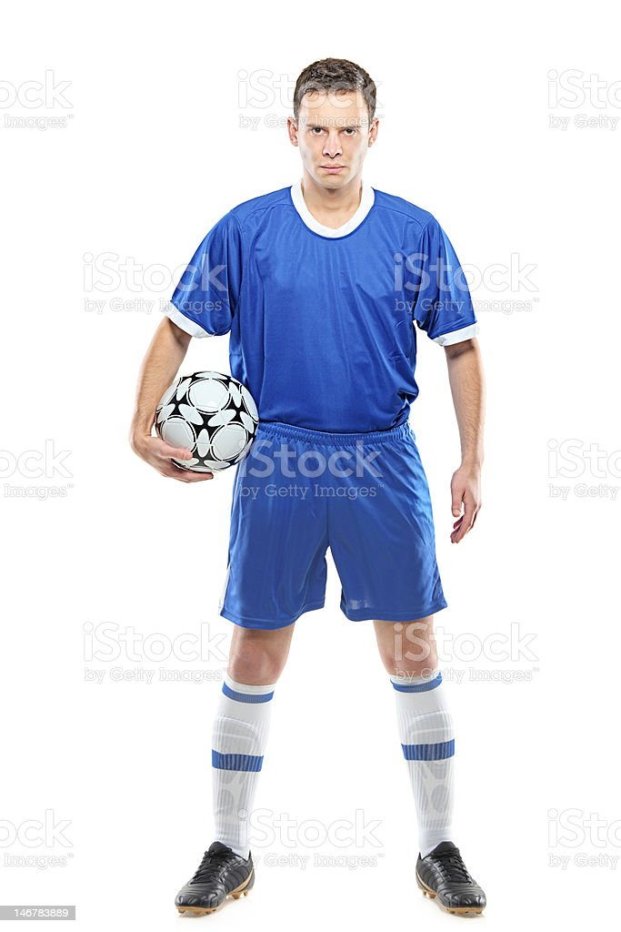 Angry soccer player with a ball royalty-free stock photo