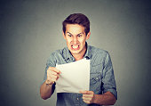 Angry stressed screaming business man with documents papers