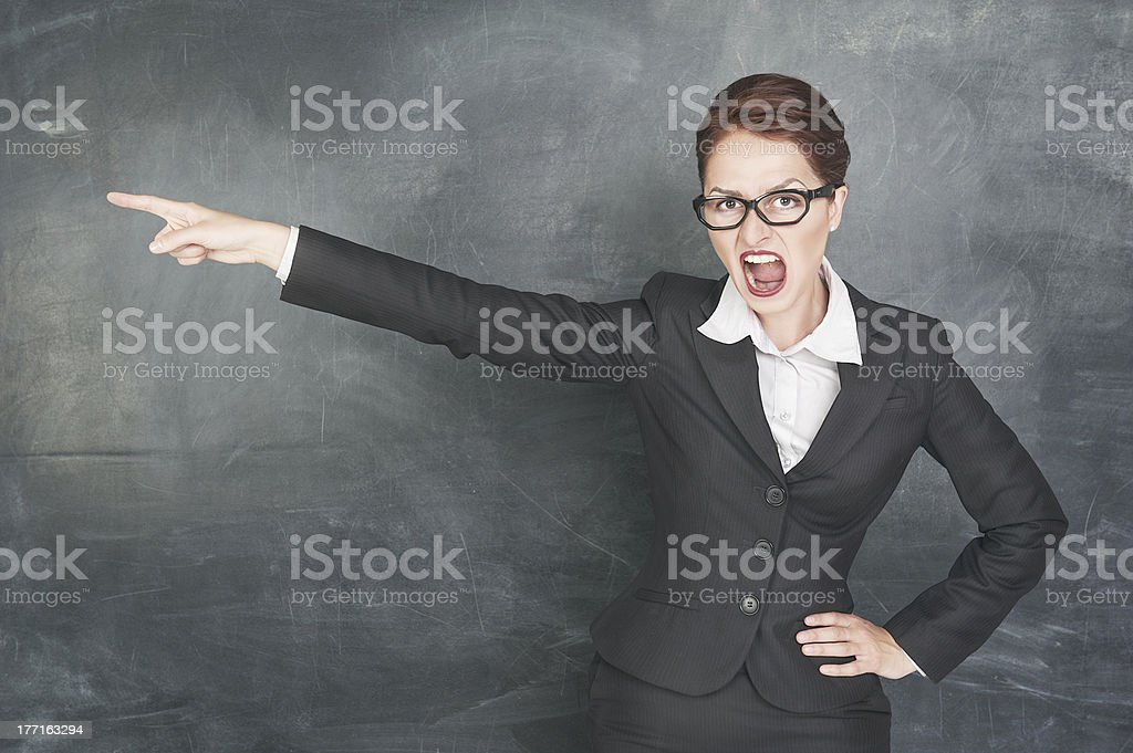 Angry teacher pointing out royalty-free stock photo