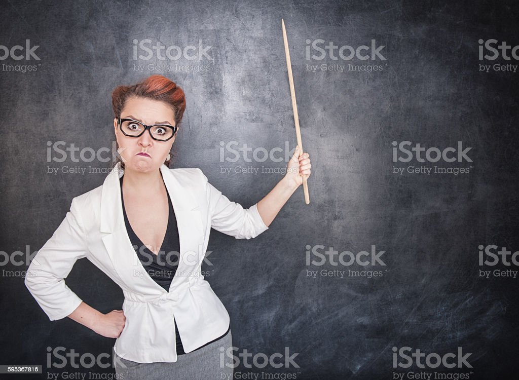 Angry teacher with pointer stock photo