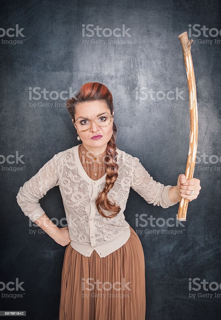 Angry teacher with stick stock photo
