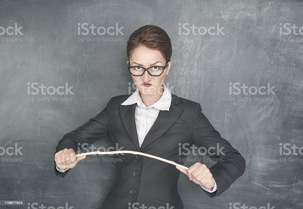 Angry teacher with wooden stick royalty-free stock photo