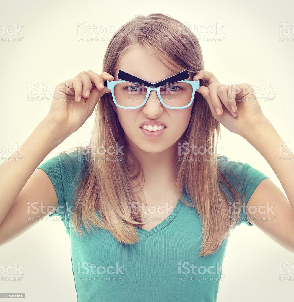 Angry teen girl wearing funny  glasses . royalty-free stock photo