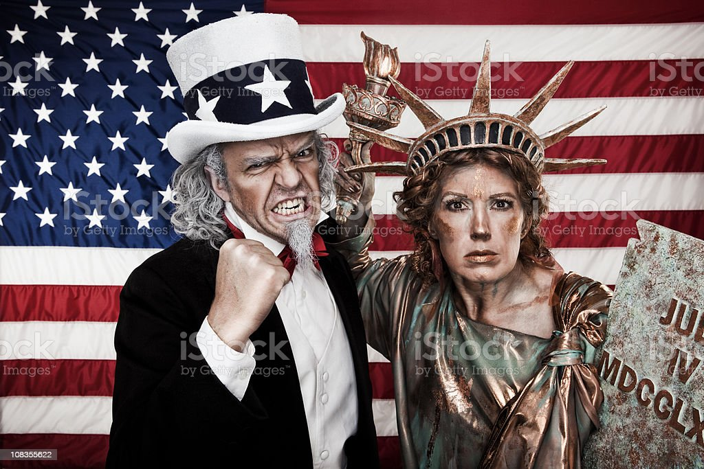 Angry Uncle Sam and Lady Liberty stock photo
