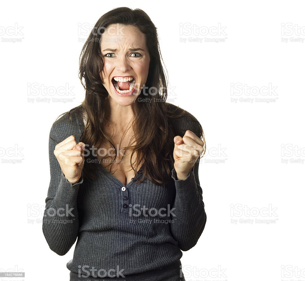 Isolated portrait of a very angry, frustrated and upset young woman.