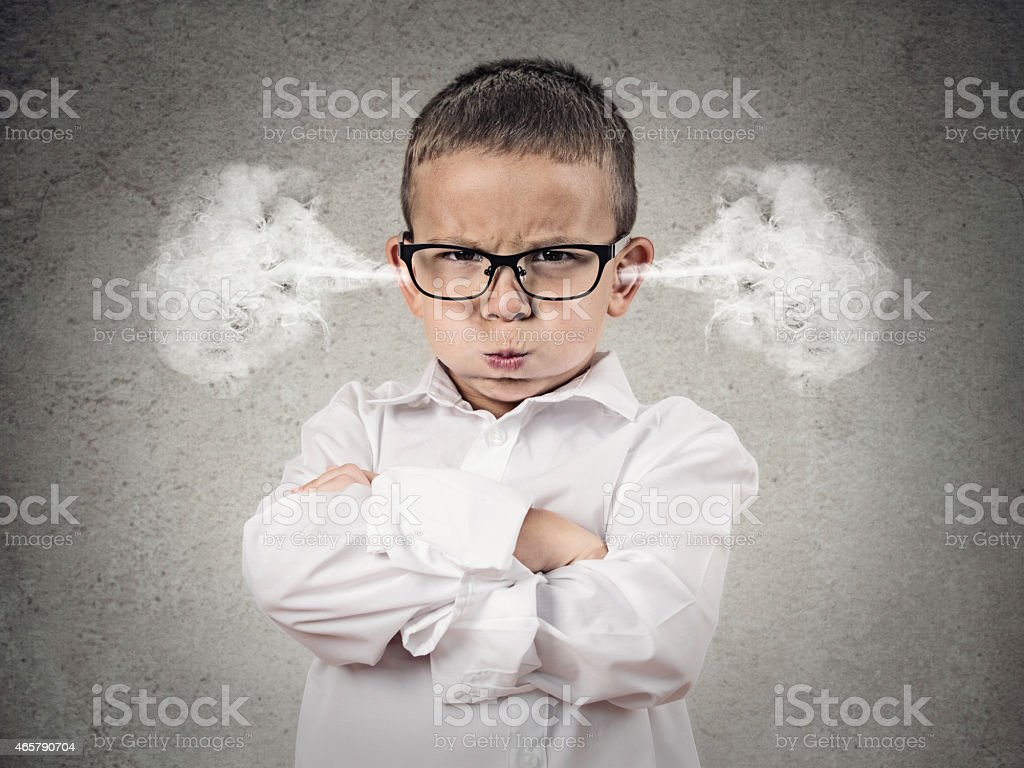 Angry upset boy, little man stock photo