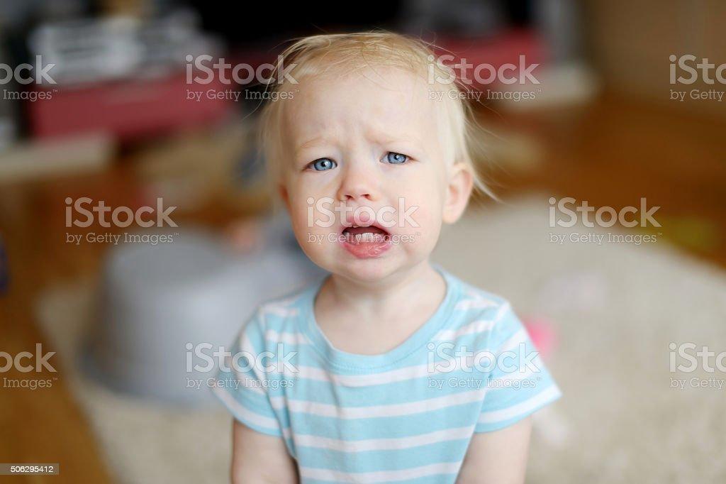 Angry upset toddler girl stock photo