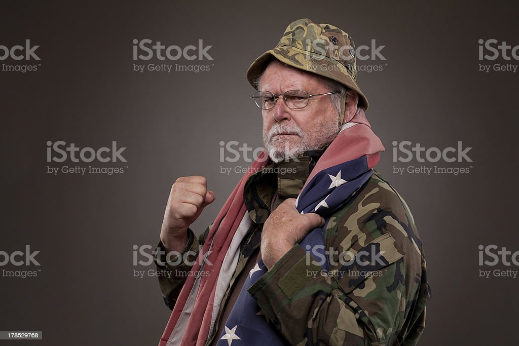 Angry Vietnam Veteran with American flag royalty-free stock photo