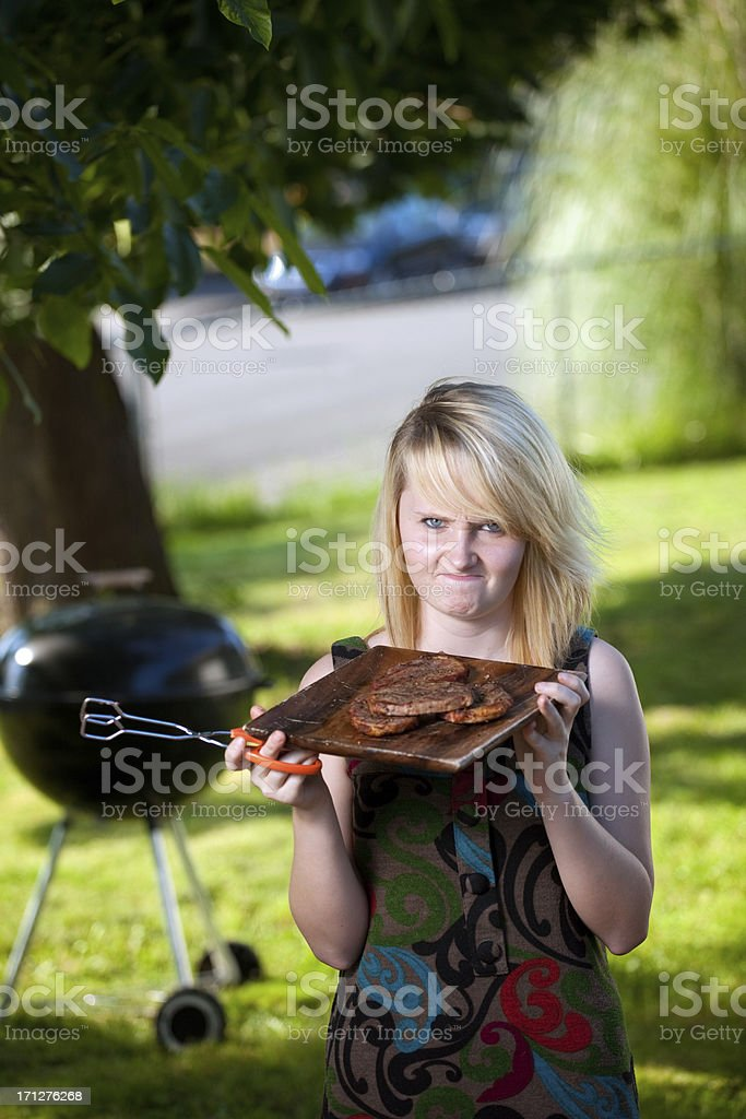 Angry Woman at Barbecue stock photo