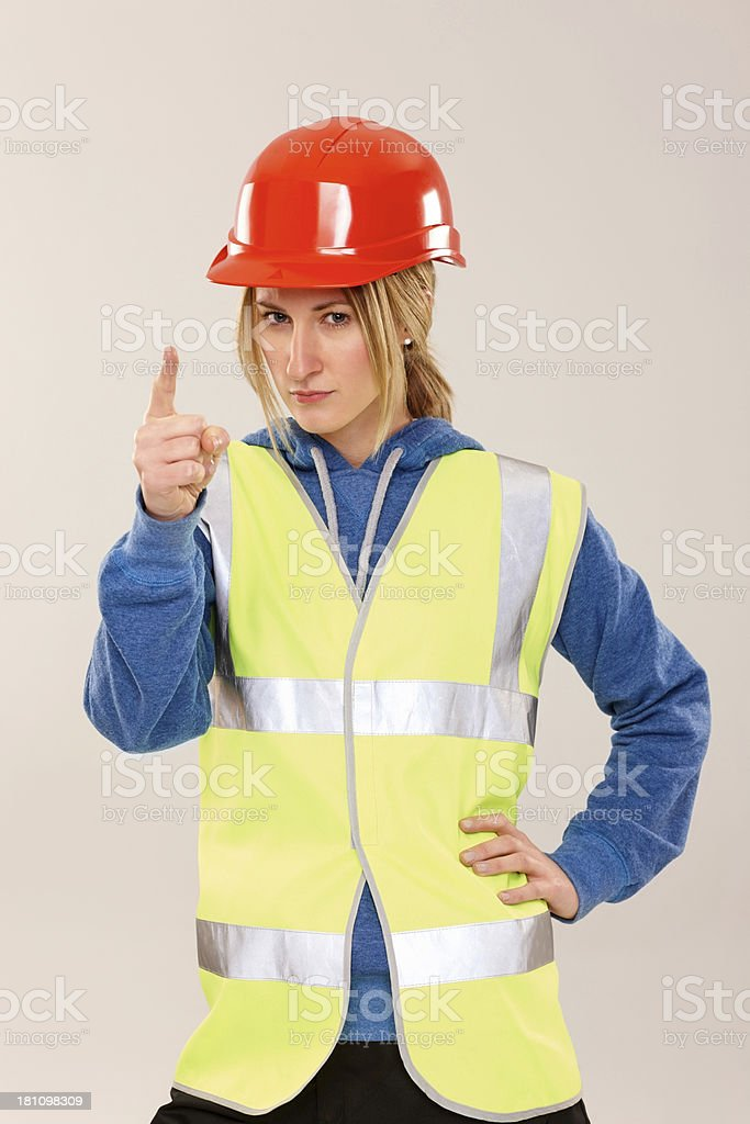 Angry woman construction worker pointing at you royalty-free stock photo