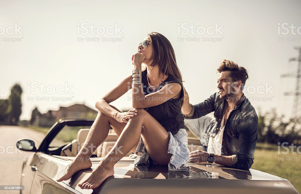 Angry woman ignoring her boyfriend after an argue. stock photo