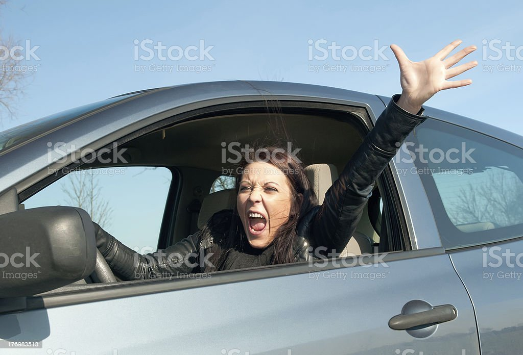 angry woman in the car stock photo