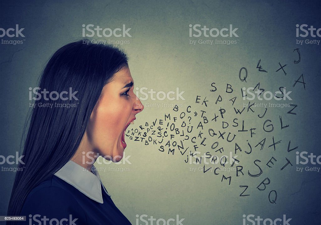 angry woman screaming alphabet letters flying out of mouth stock photo