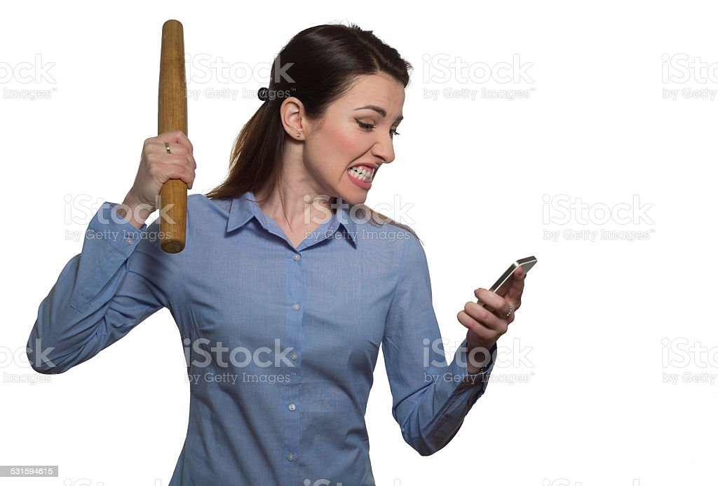 Angry woman screaming and threatens with rolling-pin stock photo