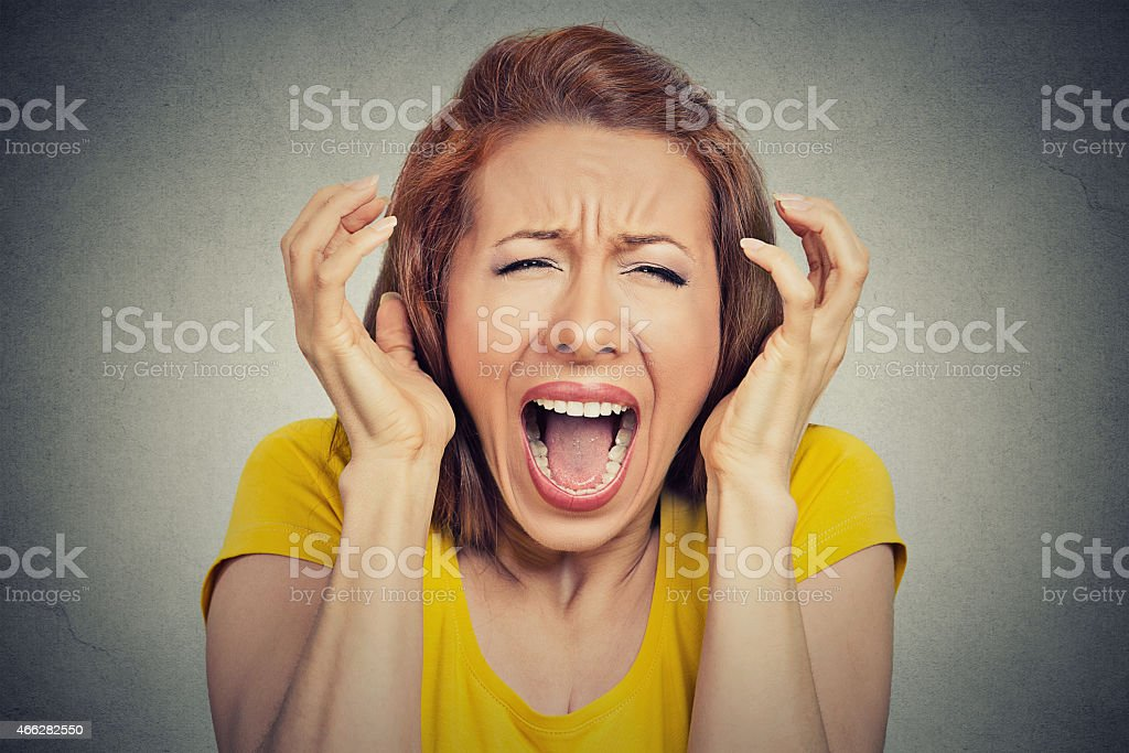 angry woman screaming hysterical stock photo