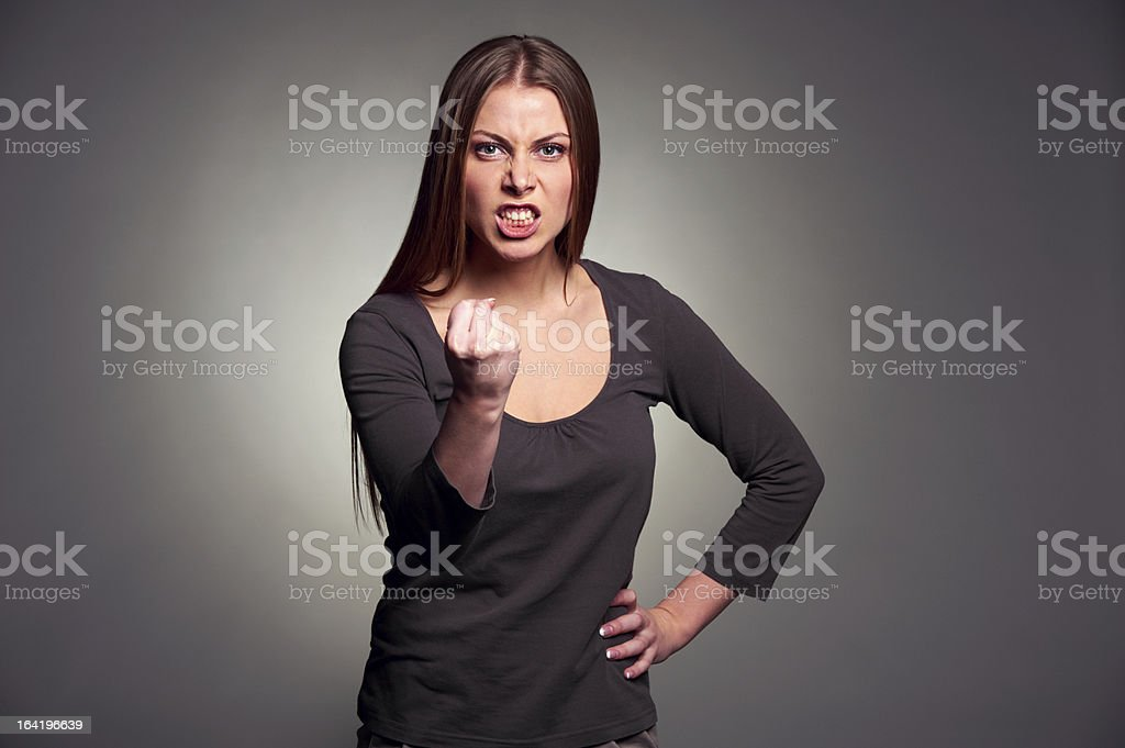 angry woman threatening the fist royalty-free stock photo