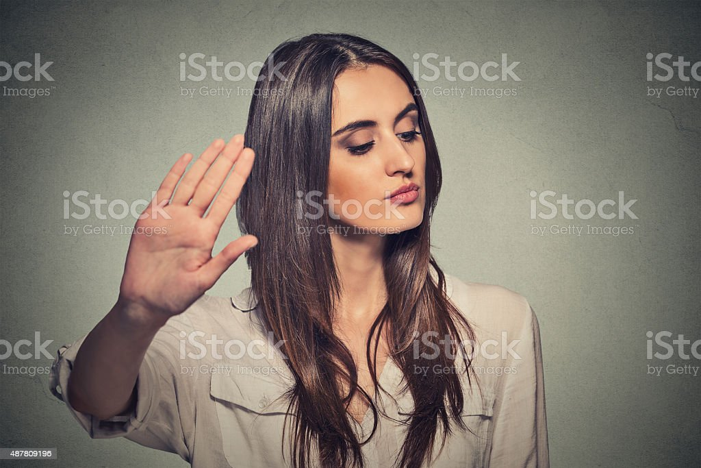 angry woman with bad attitude giving talk to hand gesture stock photo