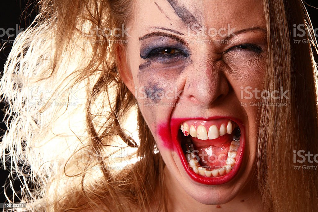 Angry Woman with Make-up Smudged on Half of Face royalty-free stock photo