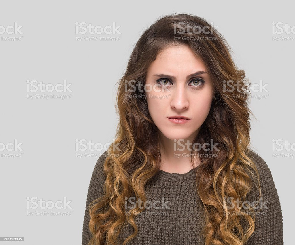 Angry women looking at camera stock photo