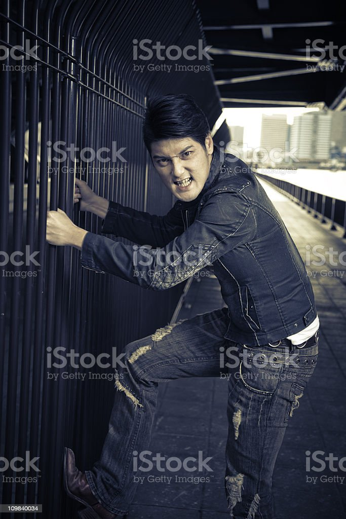 Angry Young Asian Man stock photo
