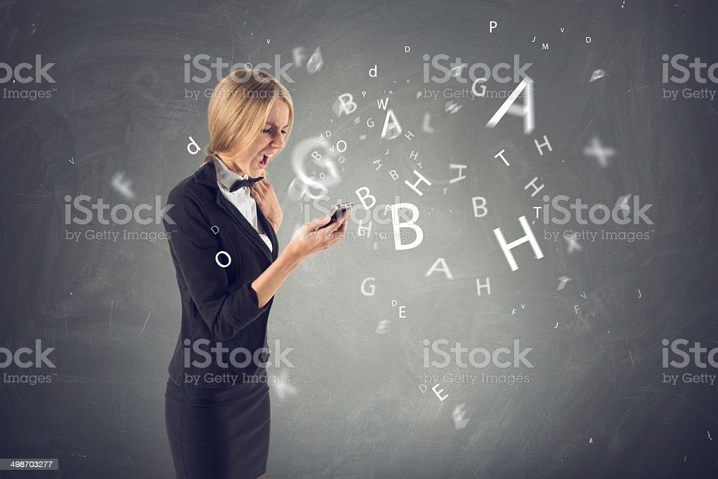 Angry young beautiful amazed woman shout screaming yelling swearwords, curse stock photo