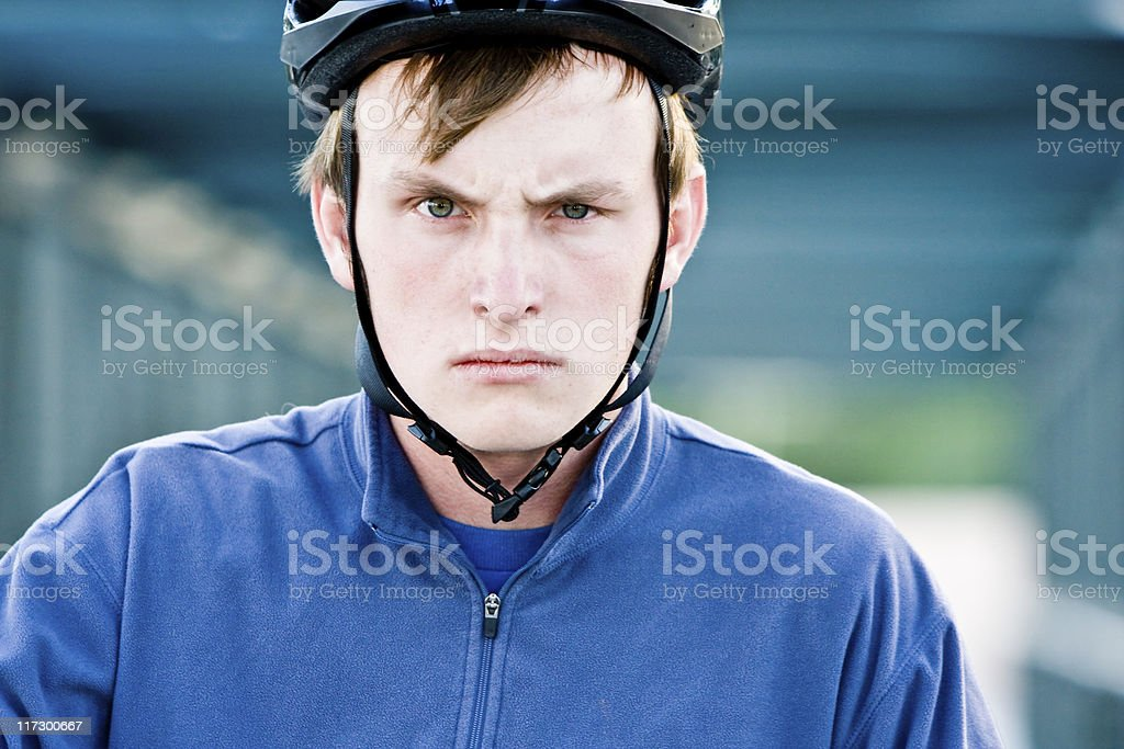 Angry Young Man in Bicycle Helmet stock photo