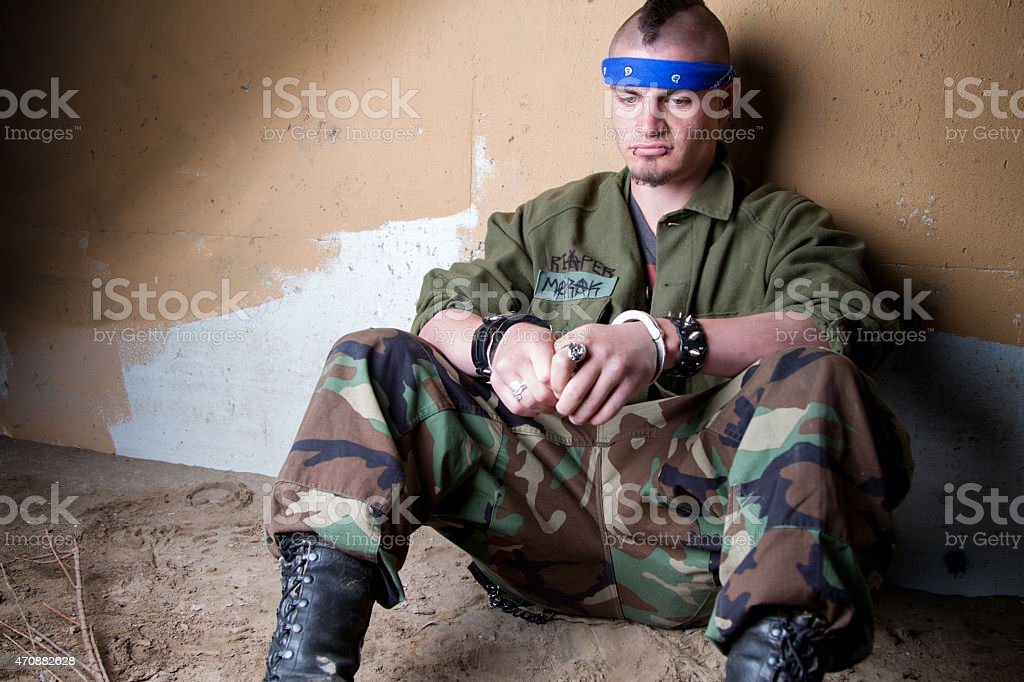 Angry Young Man in Handcuffs After Being Arrested stock photo