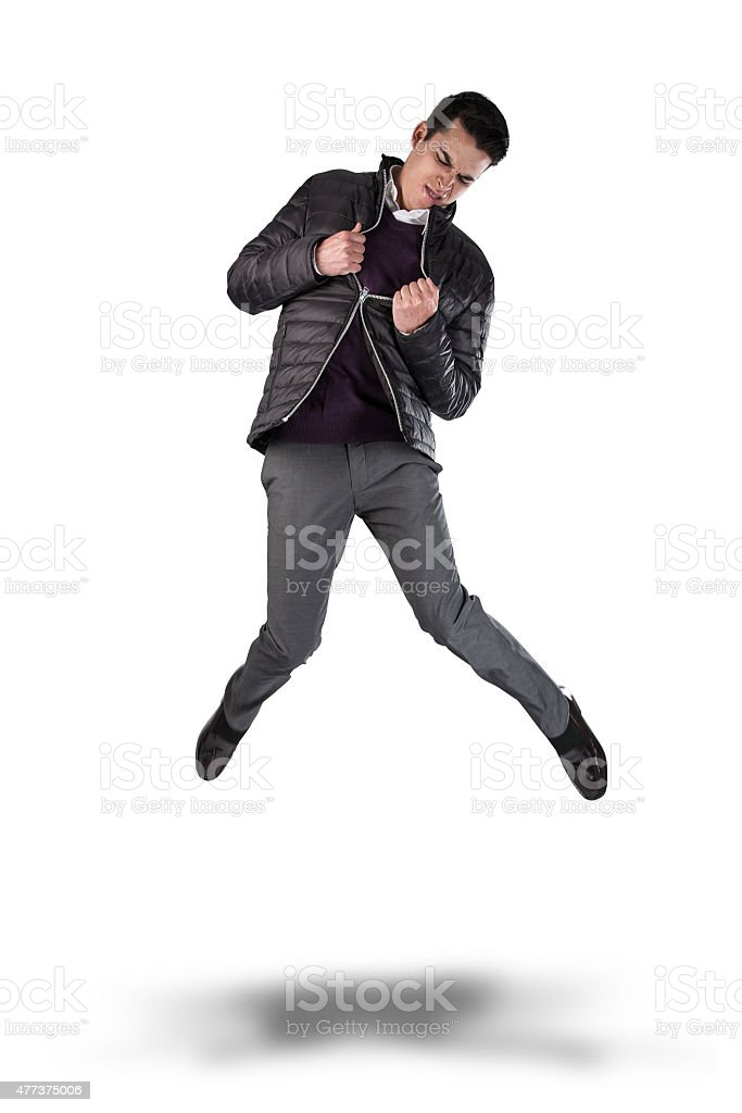 Angry Young Man Jumping and Pulling at his Broken Zipper. stock photo