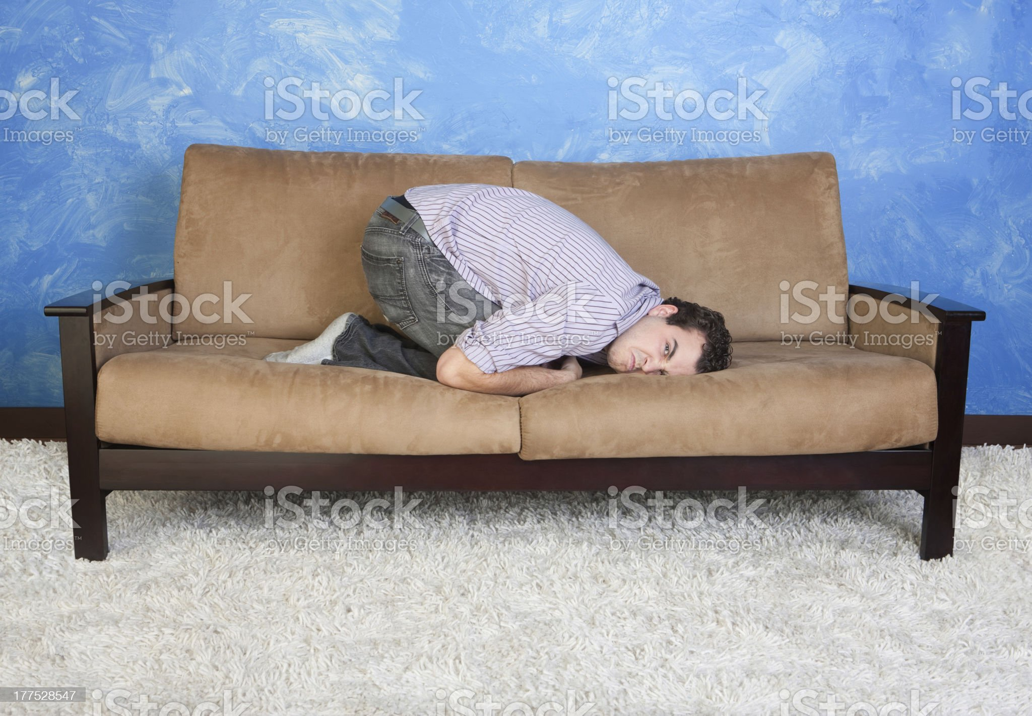 Angry Young Man On Sofa royalty-free stock photo