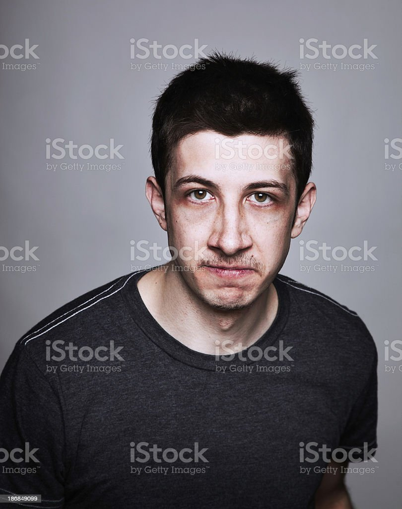 Angry young man stock photo