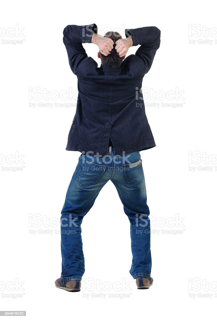 angry young man. Rear view. stock photo