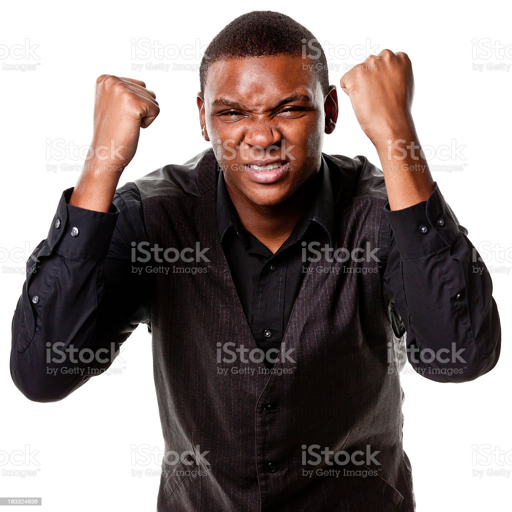 Angry Young Man Shakes Fists stock photo