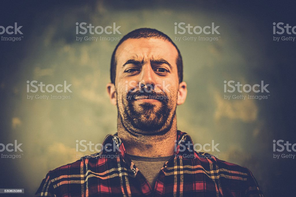 Angry young man with beard stock photo