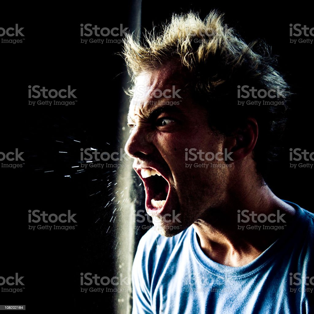 Angry Young Man Yelling and Spitting stock photo