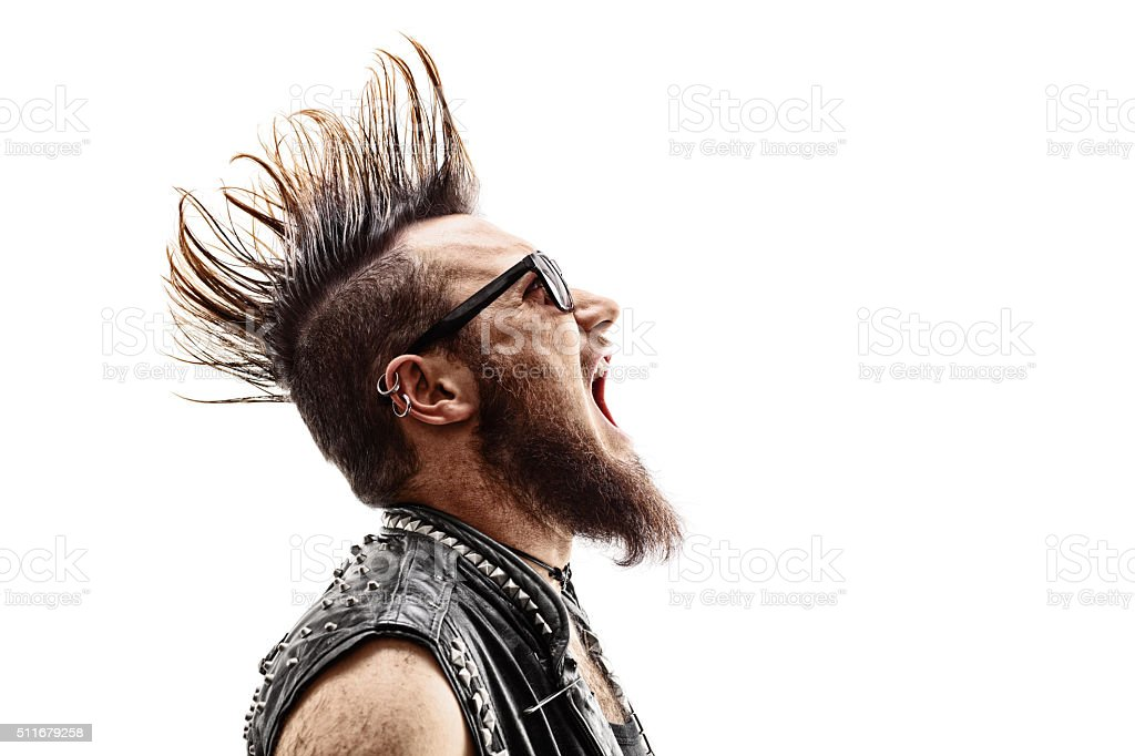 Angry young punk rocker screaming stock photo
