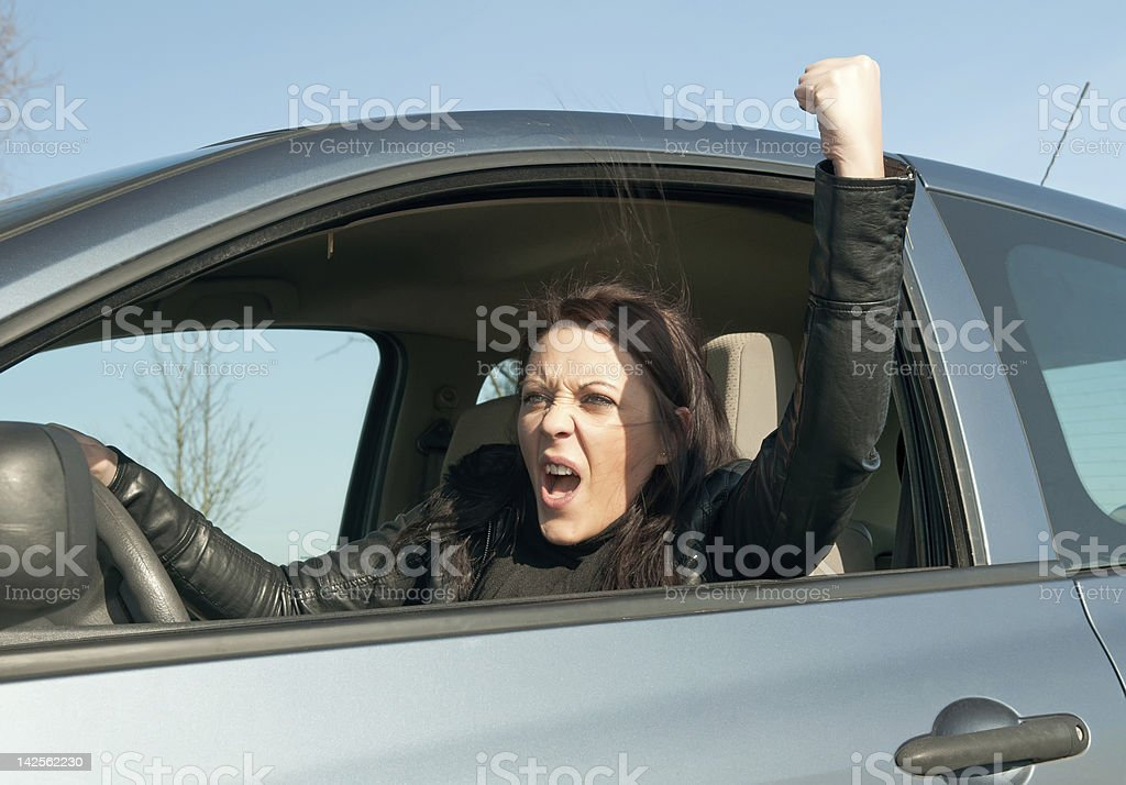 angry young woman in the car stock photo