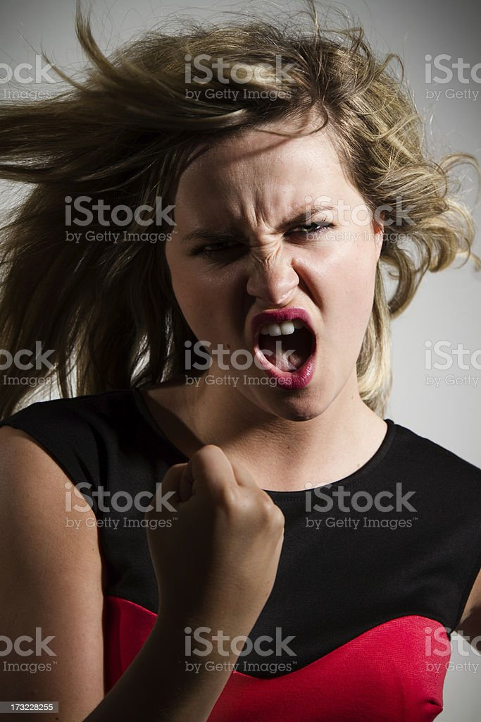 Angry Young Woman Making A Fist royalty-free stock photo