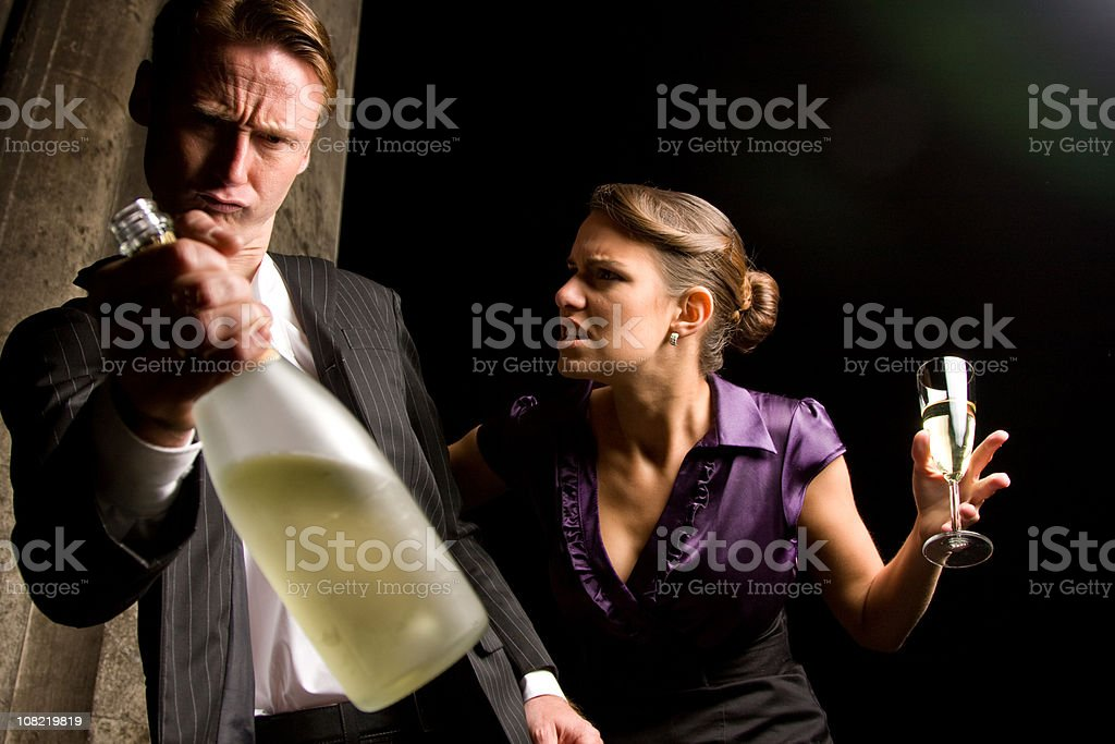 Angry Young Woman Talking to Drunk Man royalty-free stock photo