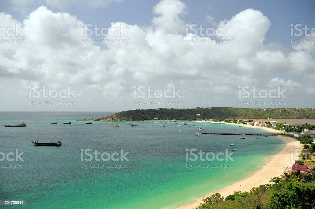 Anguilla: beach and Anguilla's commercial harbour, Road Bay stock photo
