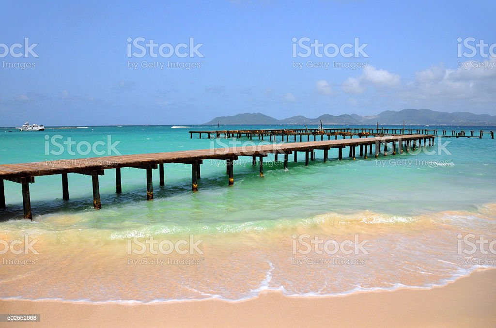 Anguilla: old wooden pier and Saint Martin island stock photo