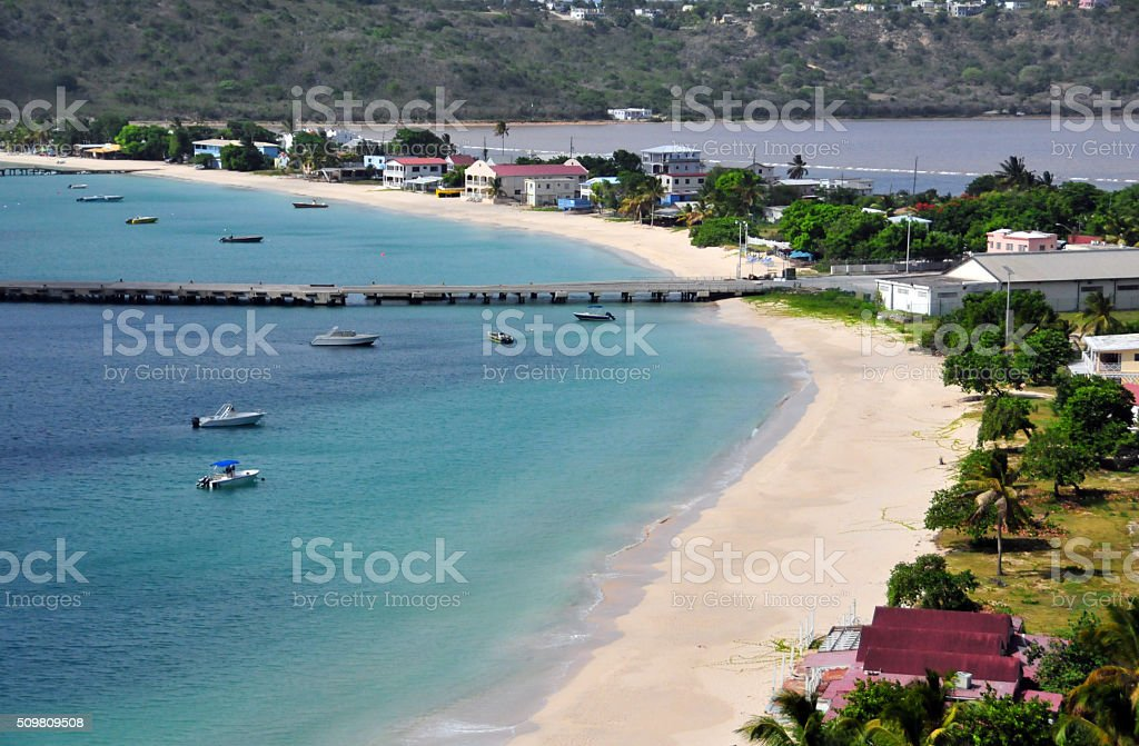 Anguilla: Road-bay beach and the cargo pier, Sandy Ground village stock photo