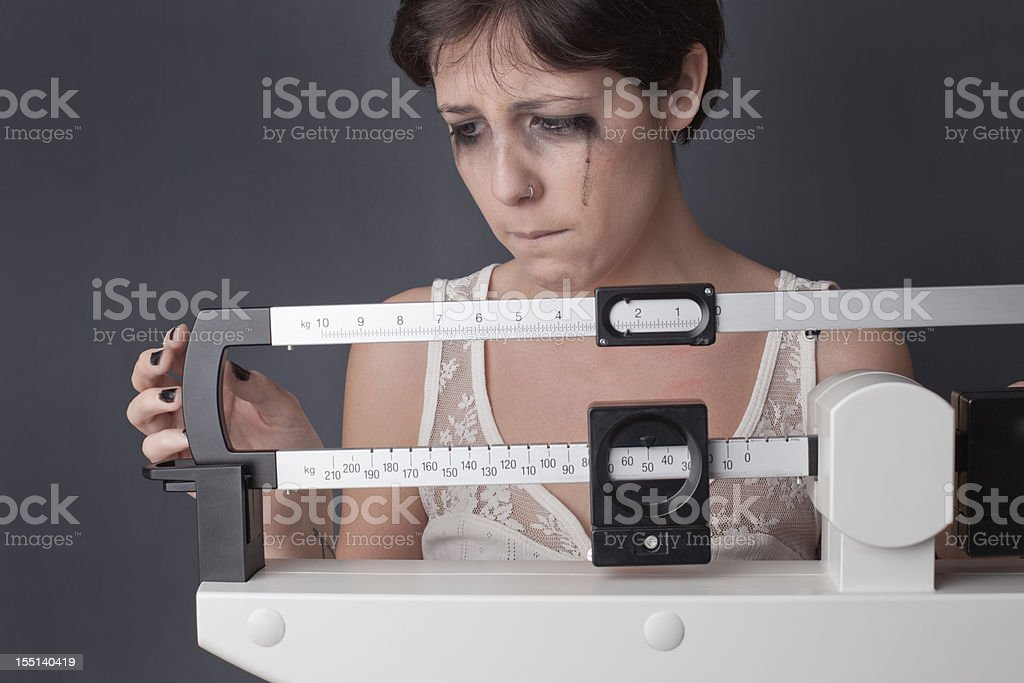 Anguish on the scale royalty-free stock photo