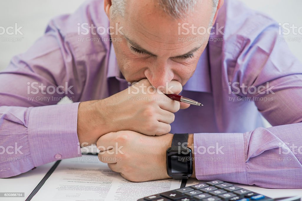 Anguished sad depressed lonely business man stock photo