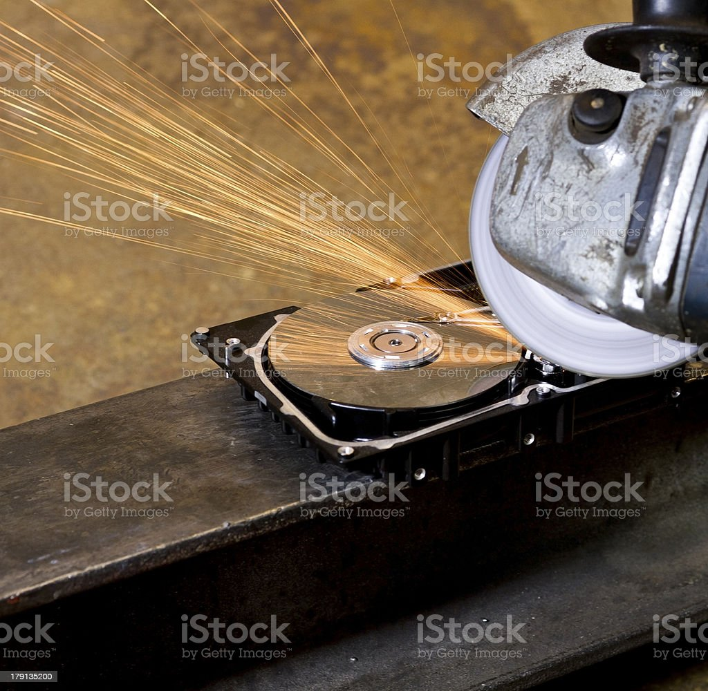 angular grinder cleaning data from hard drive royalty-free stock photo