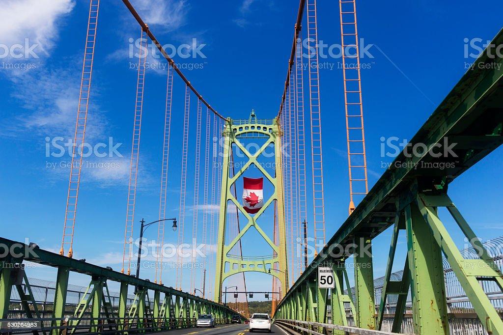 Angus L MacDonald Bridge with Canadian Flag stock photo