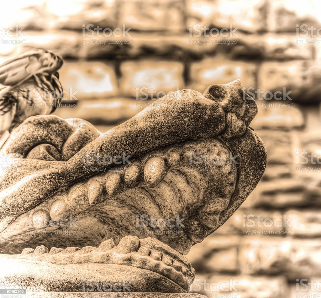 animal head in Hercules and Cacus statue in sepia tone stock photo