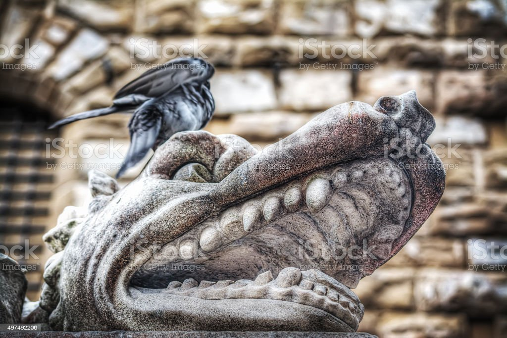 animal head in Hercules and Cacus statue stock photo