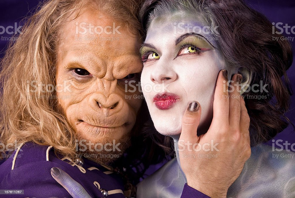 Animal Monkey Man Embracing Stage Makeup Fantasy Woman & Contact Lenses royalty-free stock photo