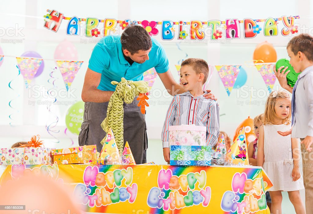 Animator entertaining little boy at birthday party. stock photo