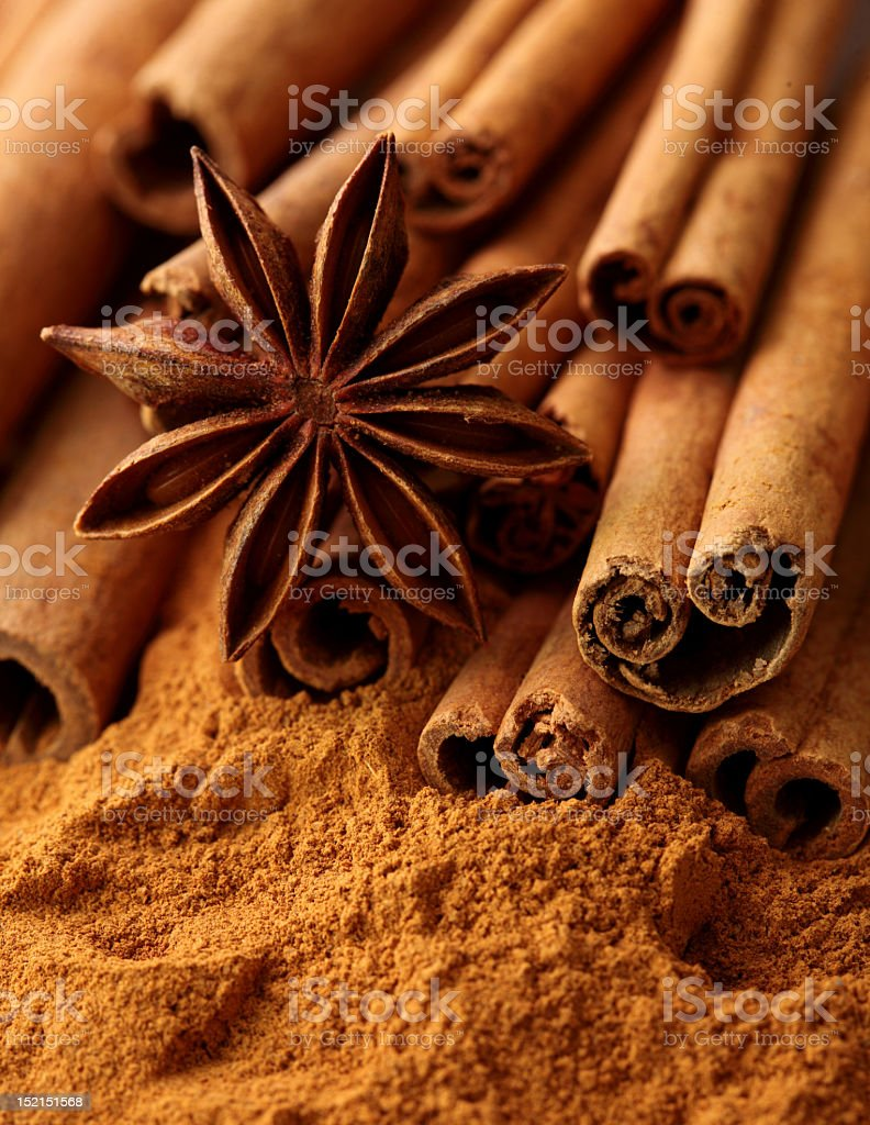 Anise and cinnamon herbs on powder royalty-free stock photo